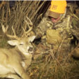Mark Kayser kills a buck during an out of state hunt